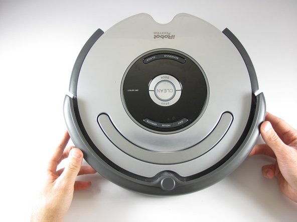 Flip the Roomba back over, so you are viewing the top.