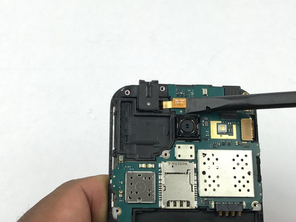 Use the flat edge of a spudger to disconnect the ear speaker connector.