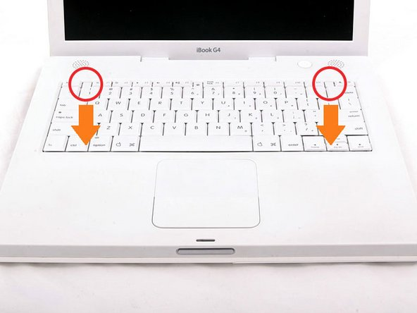 Pull the keyboard release tabs toward you and lift up on the keyboard until it pops free.