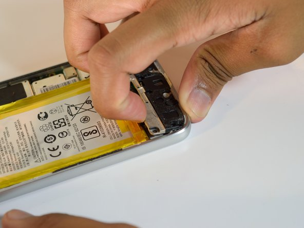Remove the panel by prying the cable cover up and lifting it out of the device.