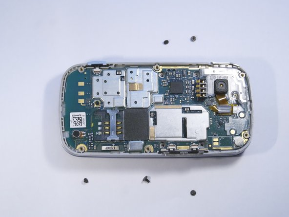 Use a PH000 driver to remove the five 2 mm screws holding the camera in place.