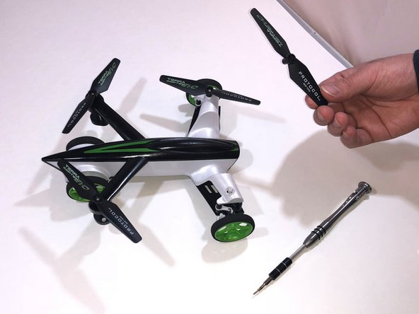 Hold the propellers gently and pull the propellers out of the drone .