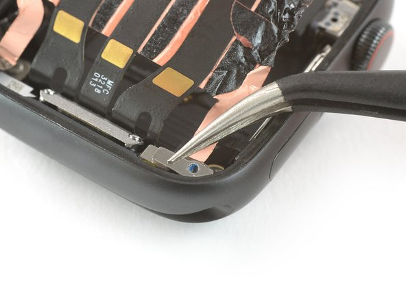 Use a pair of tweezers to remove the metal plate which covers the Force Touch gasket connector.