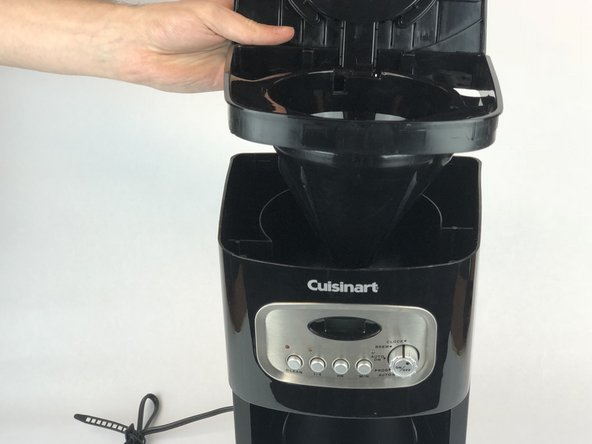 Remove the lid from the coffee maker.