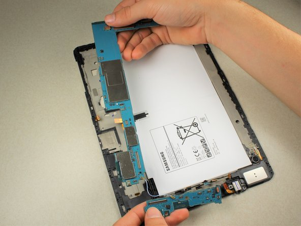 Remove both pieces of the motherboard carefully from the back panel.