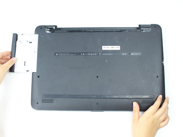 Remove the optical drive by pushing it in and then it will pop out.