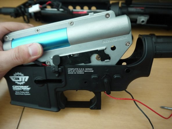 Set the selector switch to the semi-auto position, and remove the gearbox from the lower receiver, pulling it upwards and slightly forward.