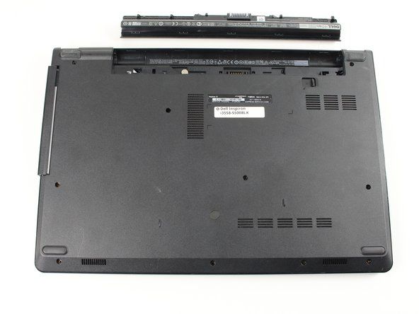 With the back of the laptop facing upright, press the switch shown to loosen the battery and remove it.