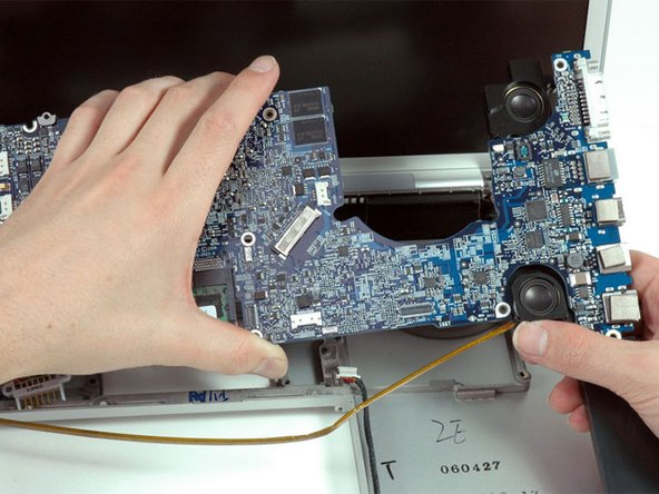 If the right speaker assembly remains attached to the logic board, hold the logic board with one hand and slide the speaker up slightly to free it from the logic board.