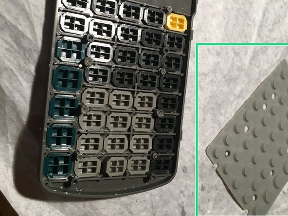 See that little gray layer? It's what transfers the button push from the plastic to the board. You can remove it to clean it. You're pretty much done! Look at step 6 for an exploded view.