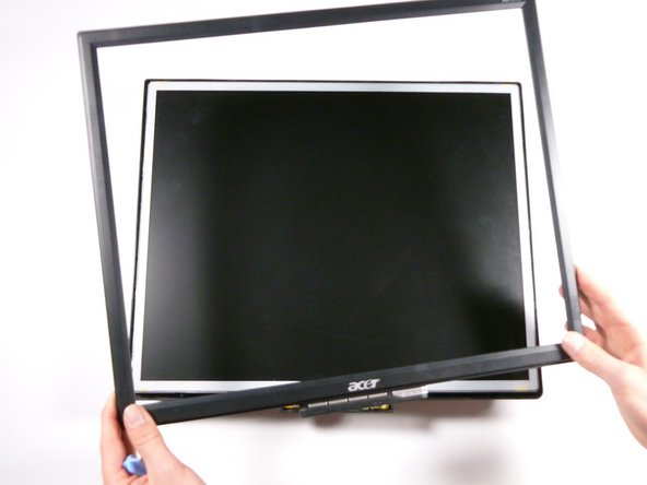 Continue around the perimeter of the monitor until the display bezel comes off.