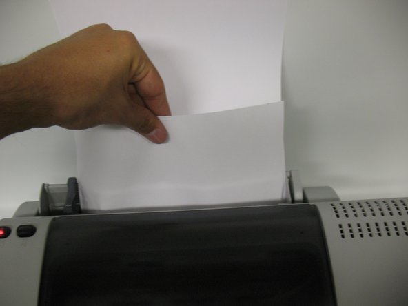 Pull the paper slowly, and as straight as possible.