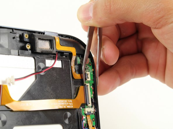 Use the tweezer tool to flip up the three small plastic locks attached to the digital board.
