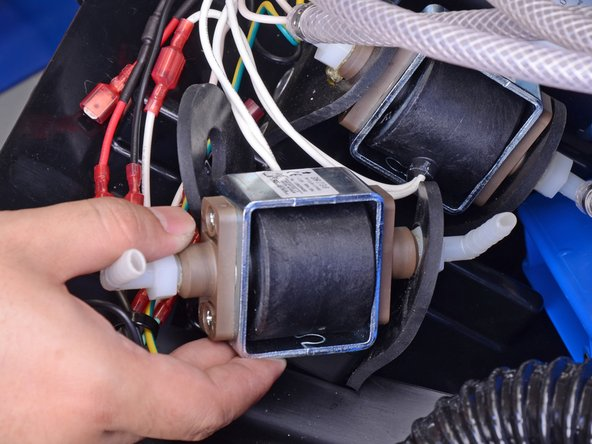 Slide the pump out of the rubber mount.