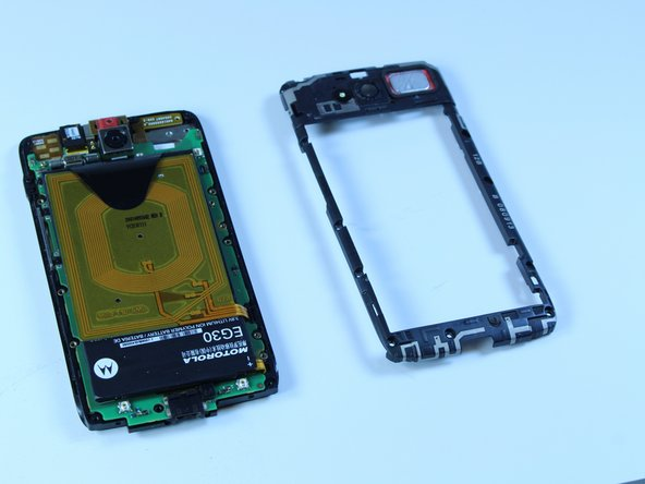 Carefully separate the housing frame from the motherboard.