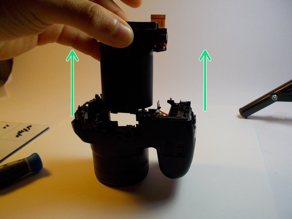 Image 2/2: Remove the lens by lifting it up from the cavity.
