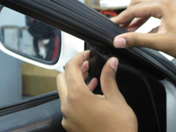 Remove the plastic cover at the base of the C-pillar by pulling it directly away from the window.