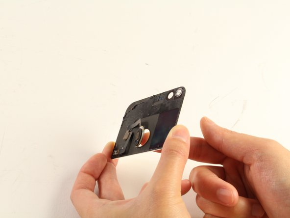 If the plastic opening tool is not working properly to remove the scanner, you may push it out with your finger.