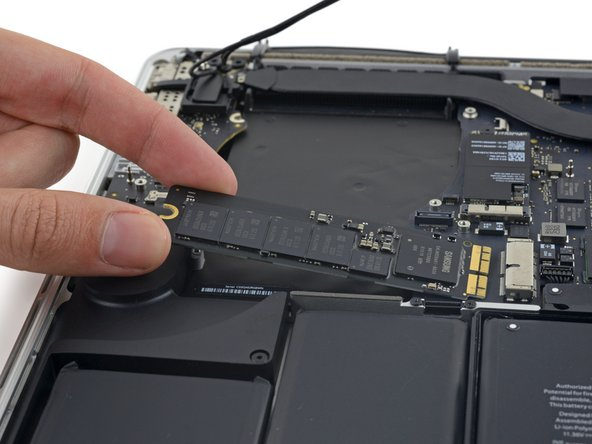 Pull the SSD straight out of its socket on the logic board.
