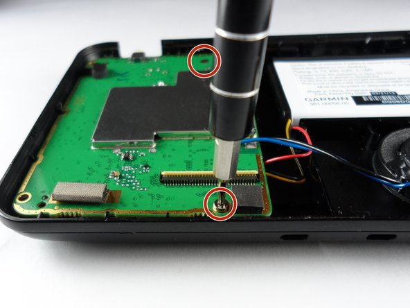 After the GPS is open, remove the two 9 mm screws holding the motherboard in place.