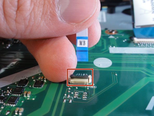 Remove each data cable from the motherboard by using your finger or the black spudger to lift the black latch.