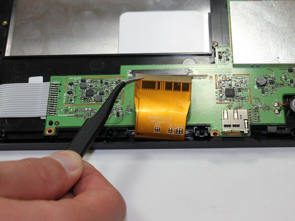 Use tweezers to carefully remove the connector between the screen to the tablet.
