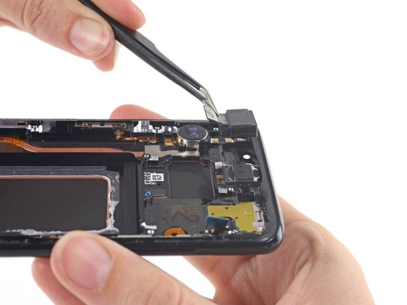 Although the motherboard is not shown in the photo, it is not necessary to remove the motherboard to remove the camera module.