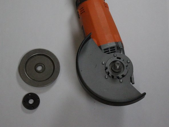 To get to the guard, unscrew and remove the Clamp Nut [34], Grinding Wheel (not pictured) [35], and Backing Flange [36].
