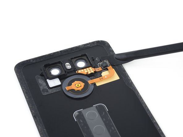 Use the blade of a halberd spudger to pry the rear button chip off of the rear case.