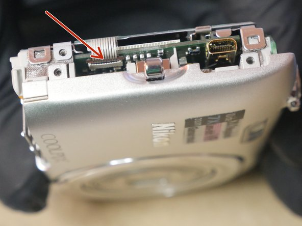 Release Flex Cable from socket.  Remove carefully.  Just pull it out using tweezers or similar tool.