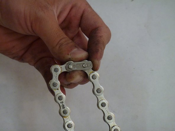 If your chain does have a master link clip replace the link around the two pins.
