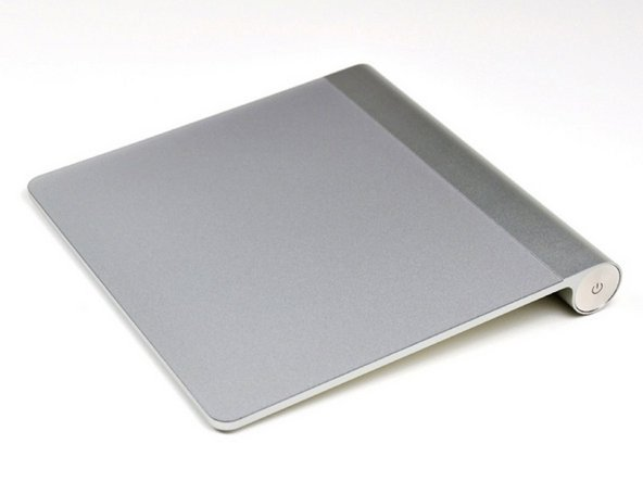 Reverse the steps to put the plastic back on the bottom of the Magic Trackpad.