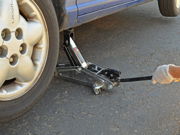 Lower and remove the jack stand from under the car.