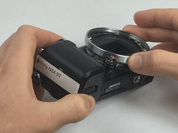 Image 2/3: Using your fingers, pull off the lens housing.