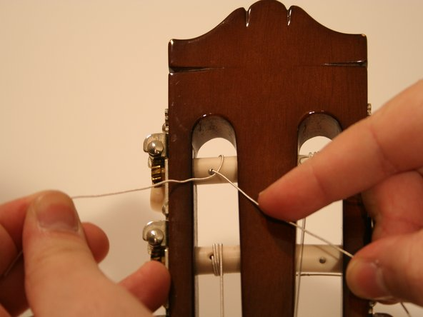 Insert the end of the string into the hole in the tuning peg.