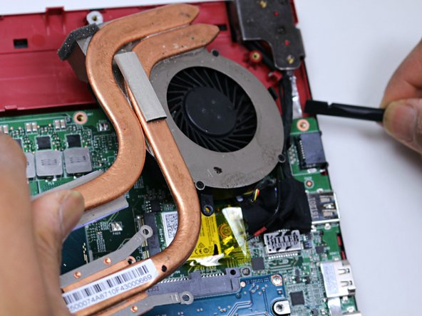 Continue to use the spudger to carefully separate the wires of the power cord from the laptop.
