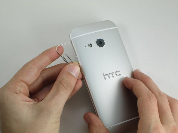 How to open sim card slot on htc one m7 magician ah gan and poker face