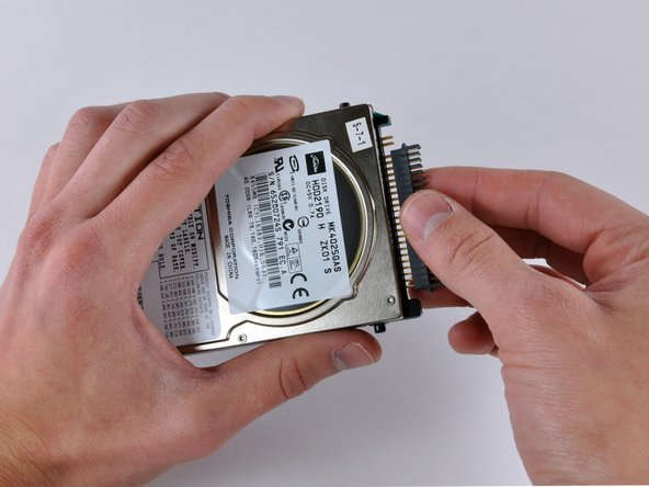 Image 1/1: Pull the plastic hard drive connector straight away from the hard drive.
