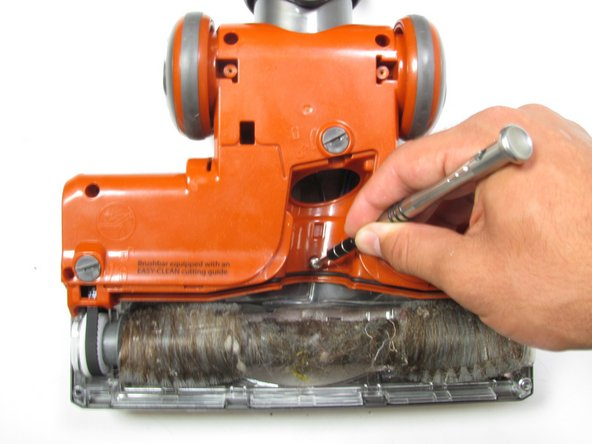 Use a Phillips #2 screwdriver to extract the three  screws revealed from removing the plate.