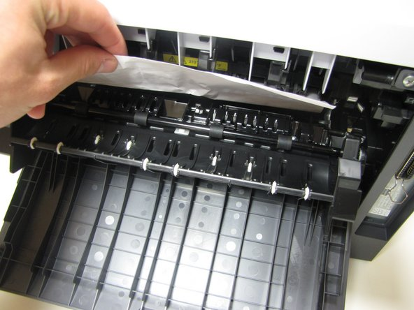 Jammed paper may require an excess amount of force to be removed from printer.