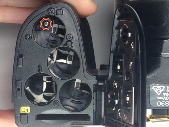 Open the battery panel on the bottom of the camera by pushing the slider up and tugging the battery panel to the right.