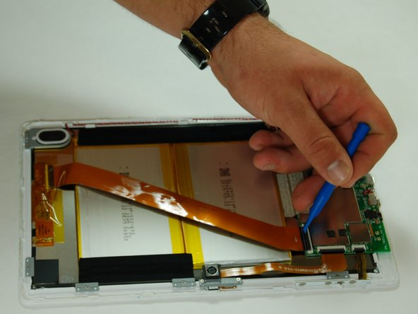 Use a plastic opening tool to flip the ribbon connector up in order to free the ribbon cable from the motherboard.