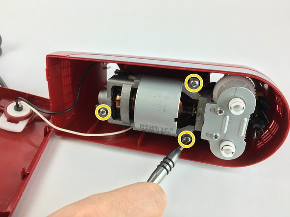 Using a Phillips 2 screwdriver, remove the three 20.0mm screws holding the motor assembly in place.