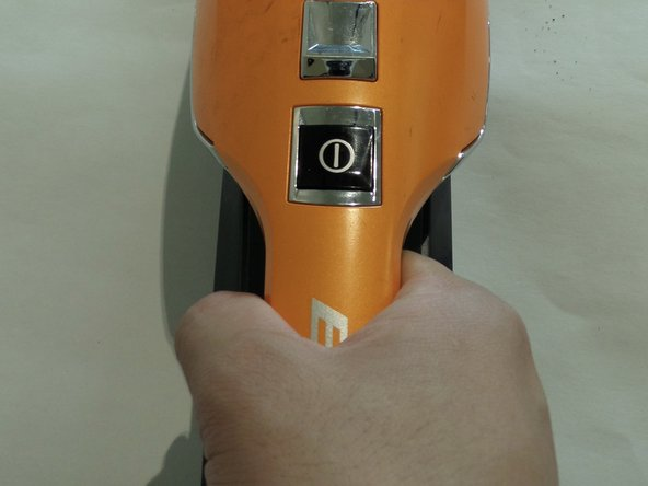 Grab the handle of the handheld vacuum.