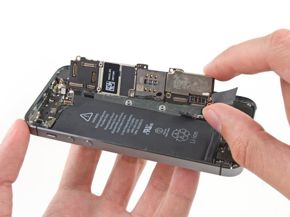Follow your iPhone's logic board replacement guide to remove the logic board. If you notice corrosion or liquid residue on other parts, follow the appropriate guides to remove those as well.