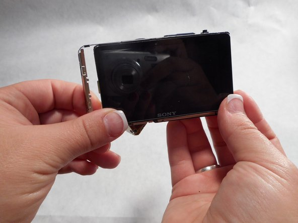Gently slide the LCD screen using very light pressure to the right until it pops open.