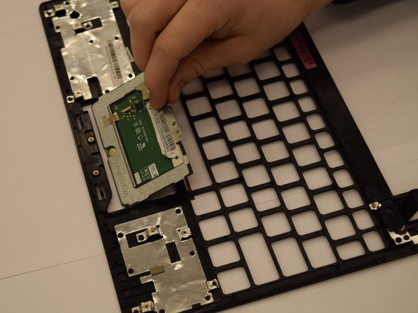 To remove the touchpad from the rest of the laptop, pull it straight out.