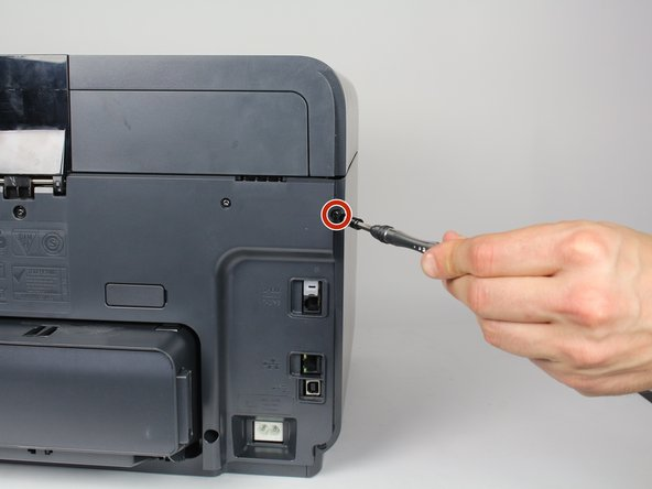 Remove two 13mm T9 screws using a T9-Torx screwdriver. Turn counterclockwise  until the screws are released.