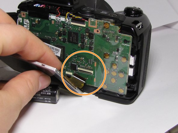 Using tweezers or fingers gently disconnect the LCD screen.