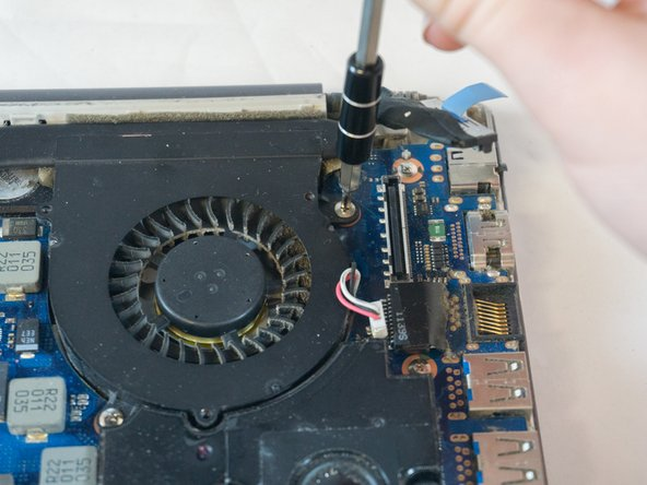 Using the Phillips#00 remove the four 3.5mm screws securing the fan to the motherboard.